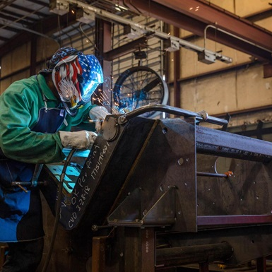 Welder working on Brandt equipment