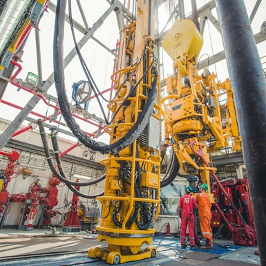 Technicians on offshore rig