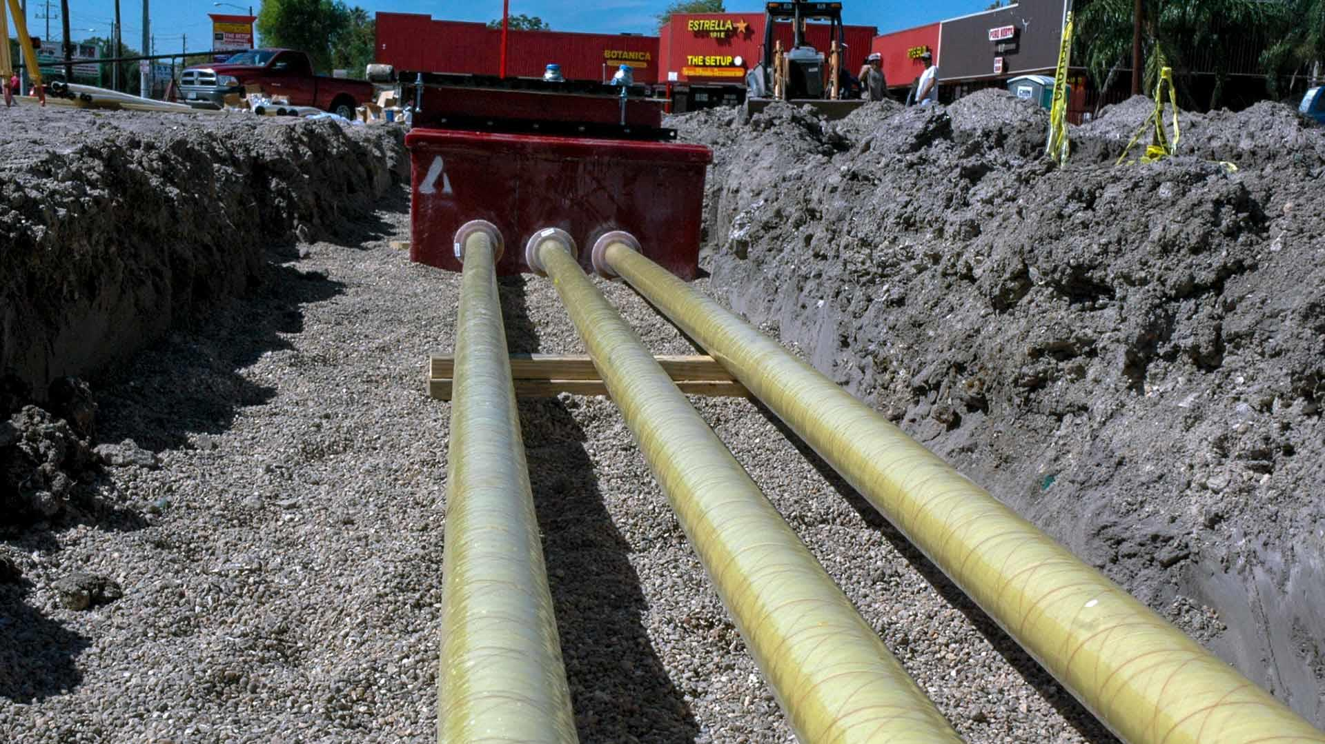 Low angle of Red Thread IIA Fiberglass Pipe in a ditch