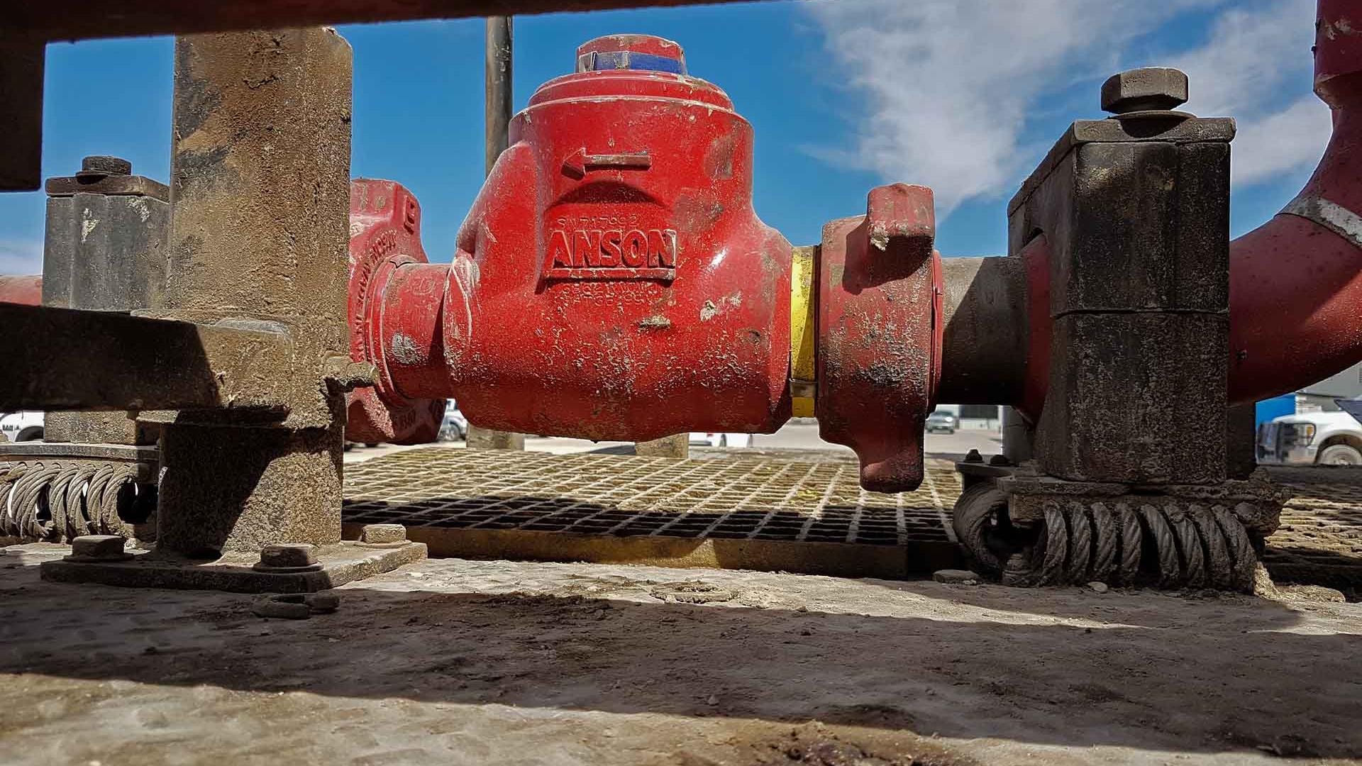Anson plug valves on rig site