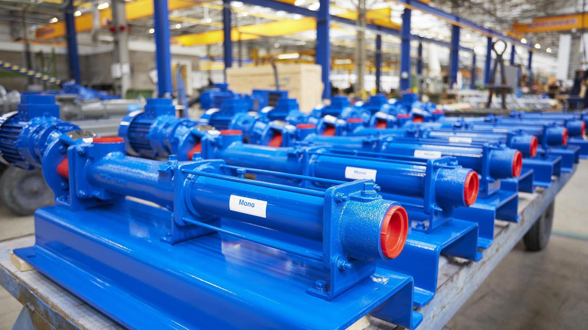 Photograph of blue Epsilon vertical pumps in a warehouse environment.