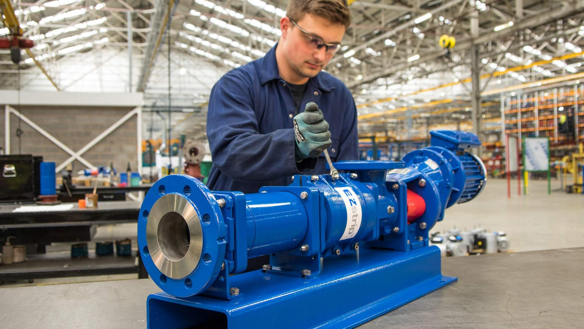 Technician assembling EZstrip Transfer Pump