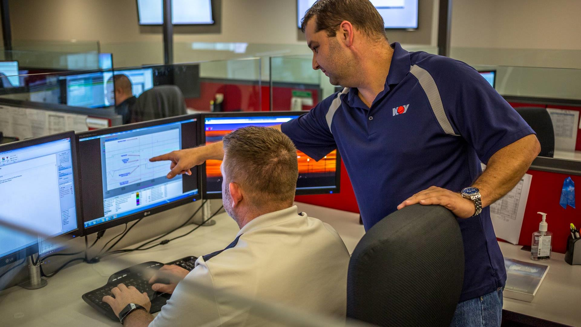 Engineers reviewing MAX data