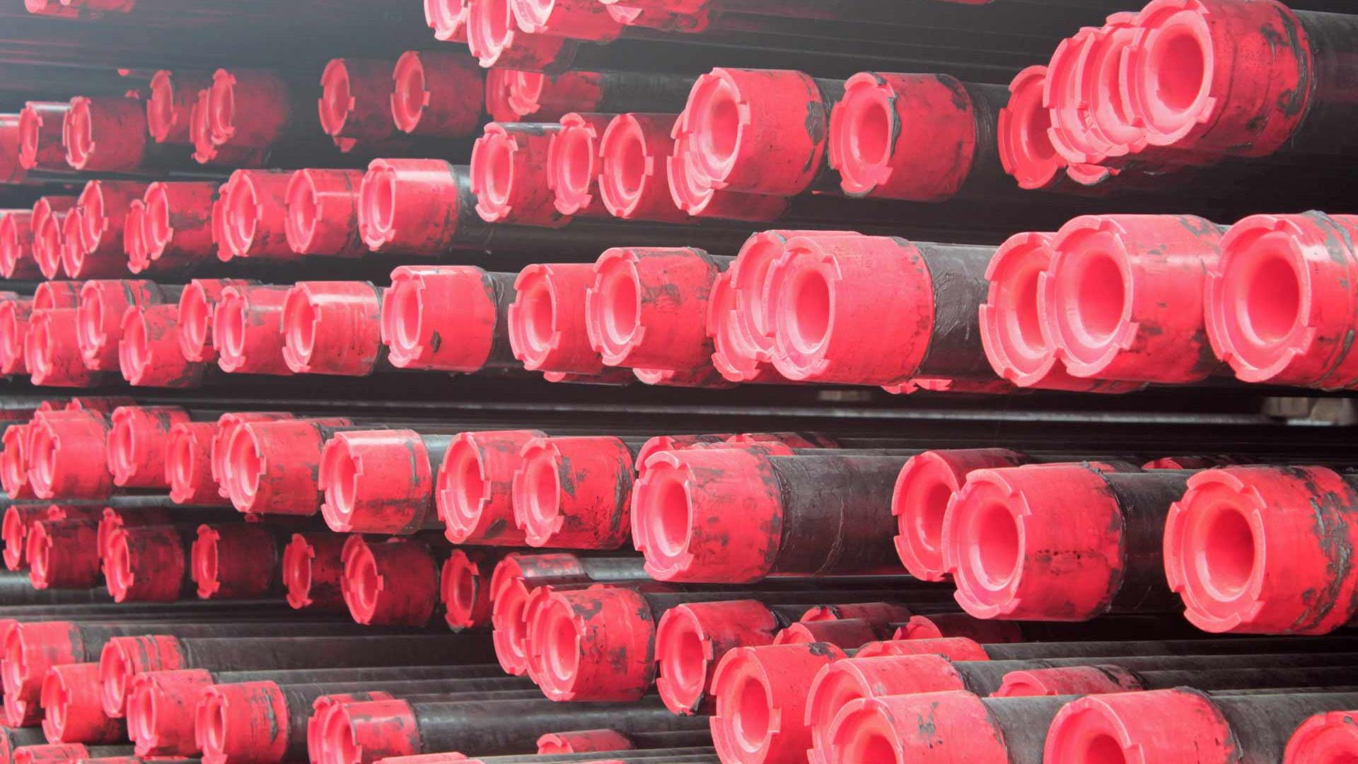 Red Magnum Casing Thread Protectors in yard