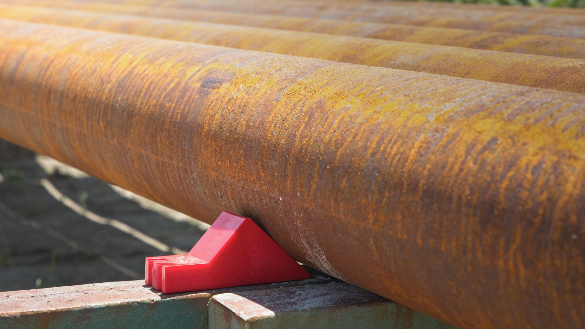 red pipe chock on pipe