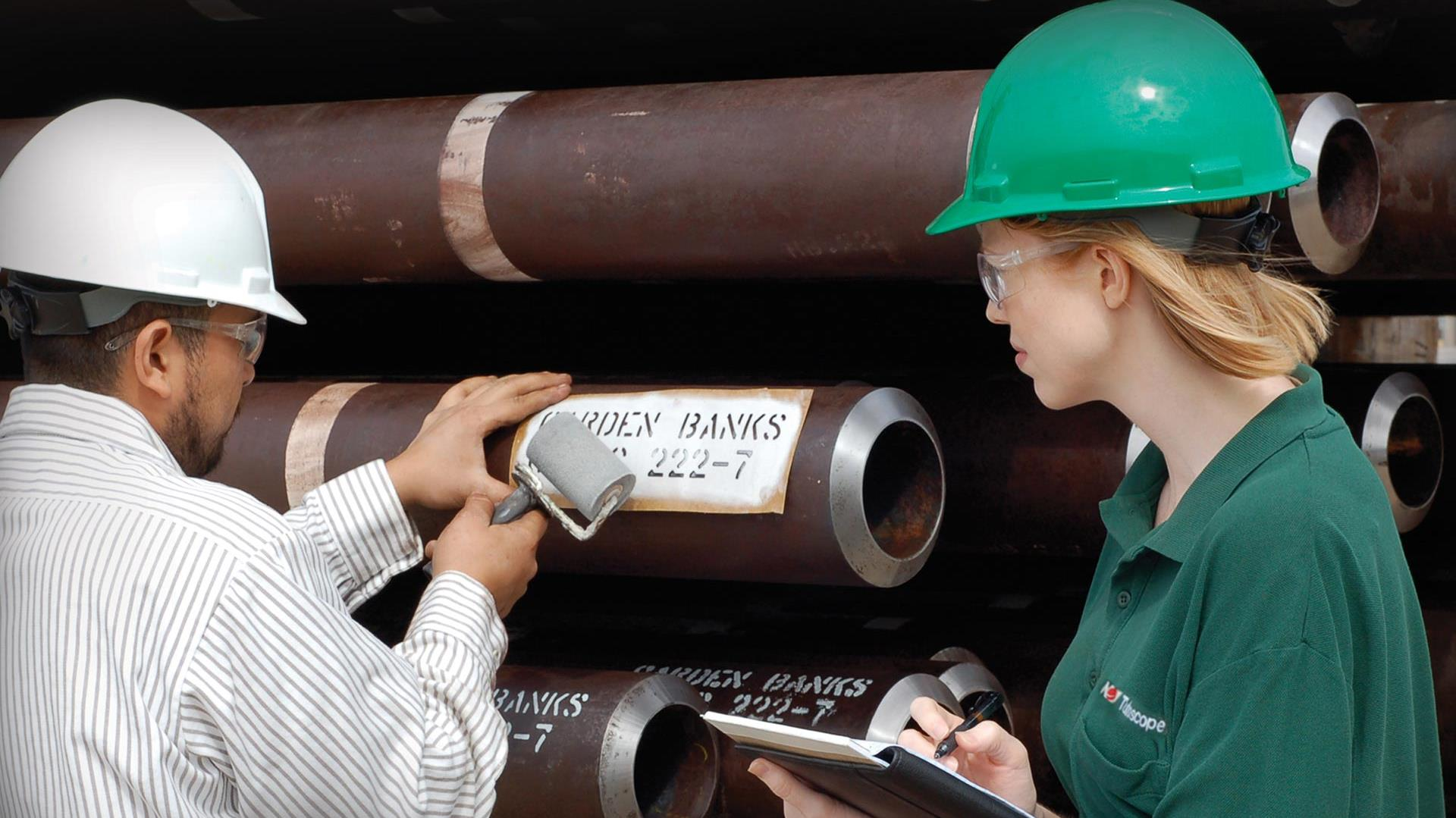 Image of a man and a woman performing pipe inspection.