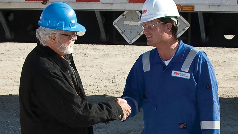Power Generation Solutions technician shaking hands with a client