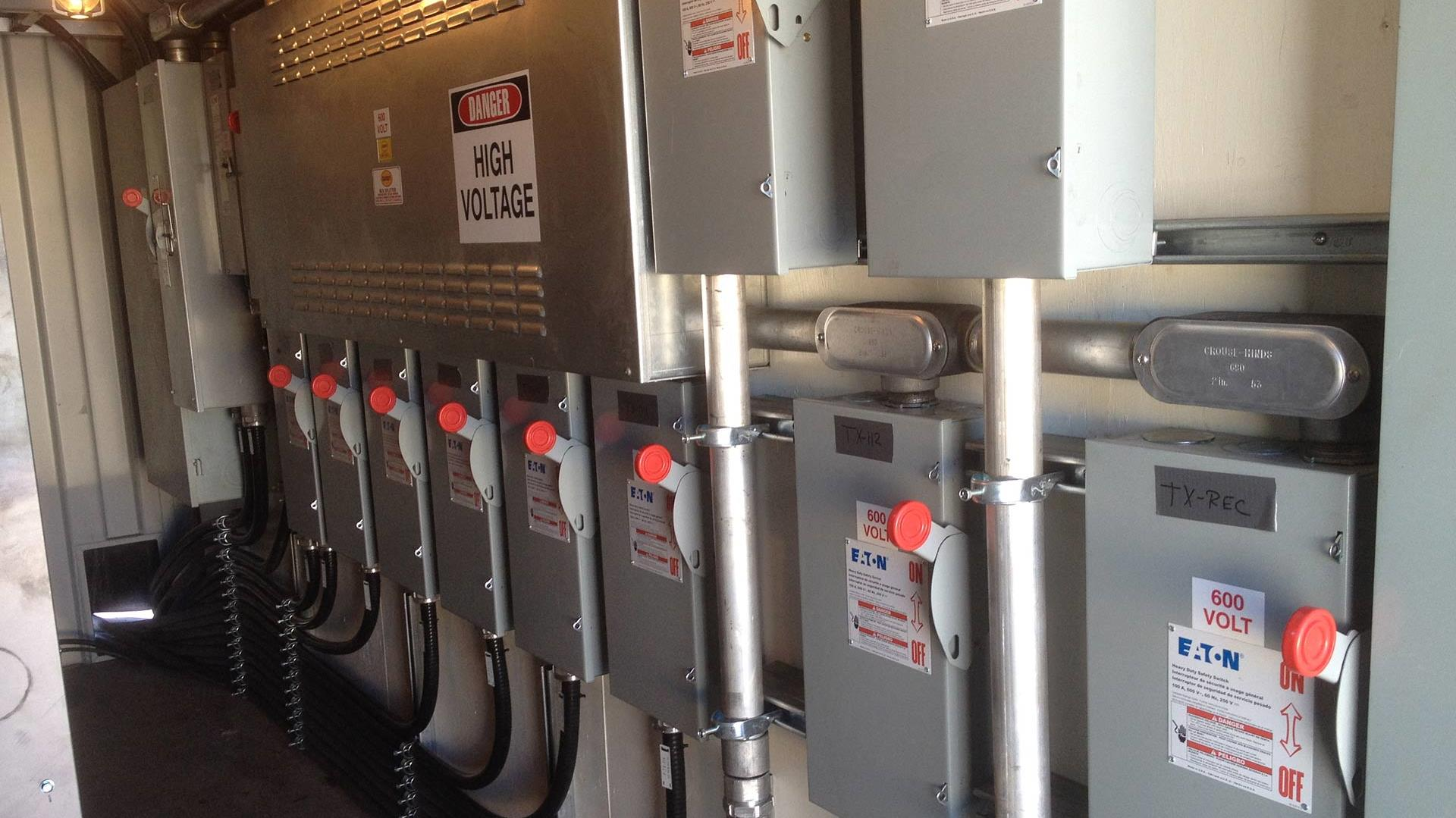 Row of high voltage breakers for Rental Generators (Canada)