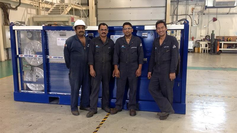 Four NOV technicians pose in front of a piece of refurbished and recertified Elmar equipment