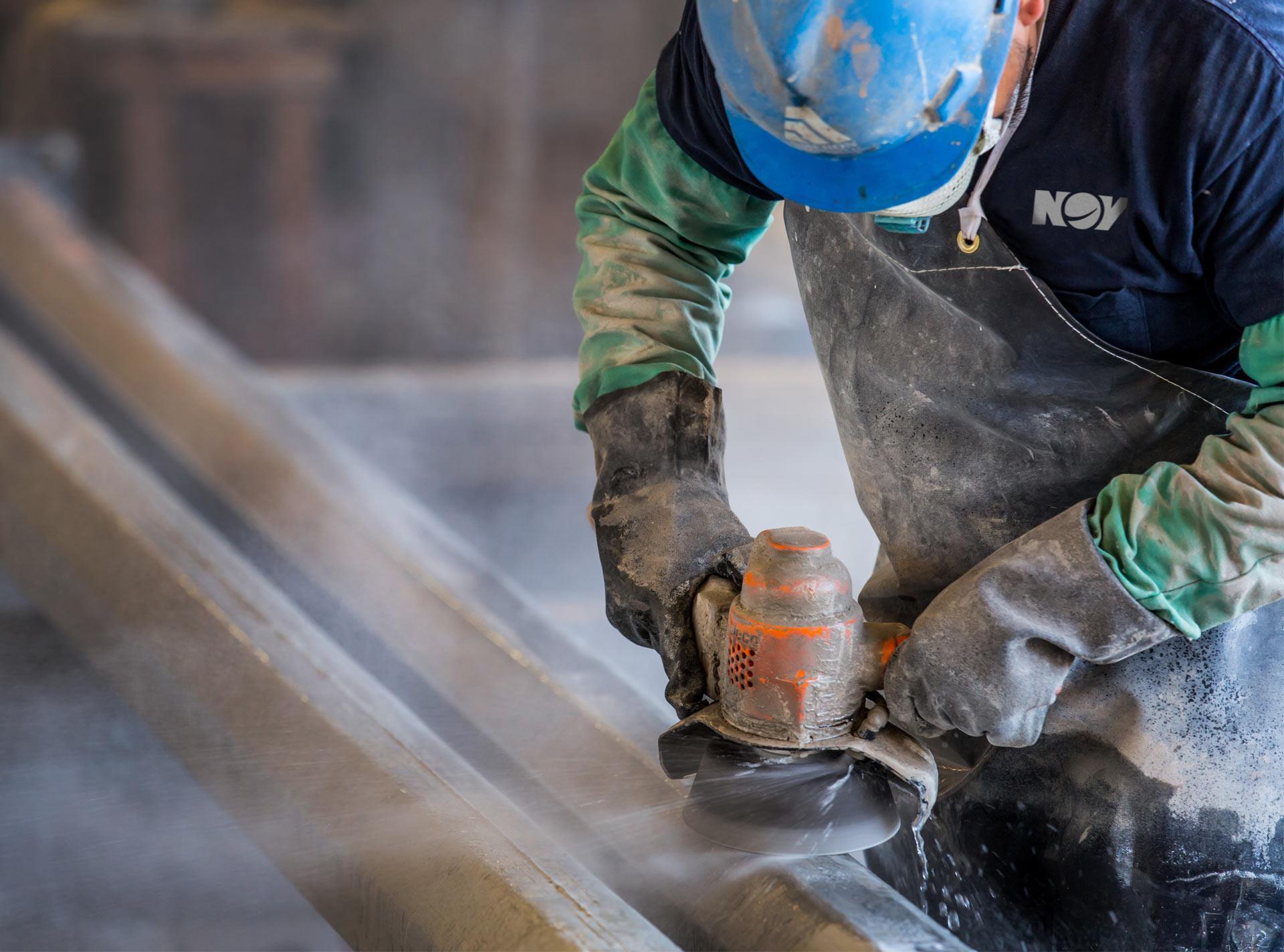 Ameron technicain sanding concrete pole