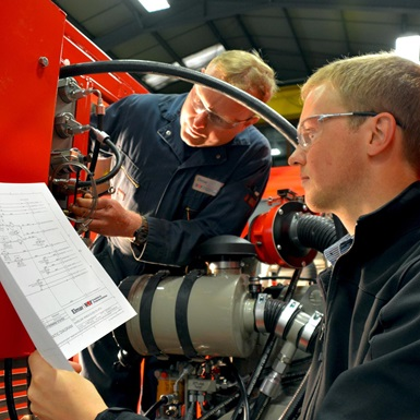 A manufacturing engineer performing a product check