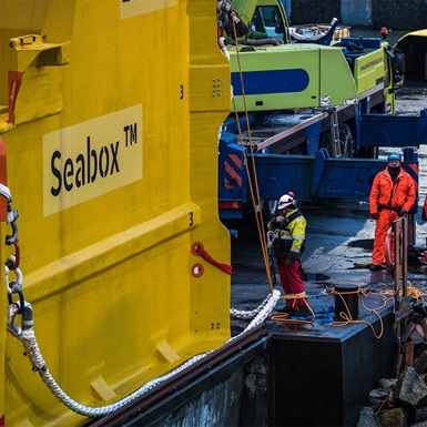 Workers look at a seabox subsea water treatment unit