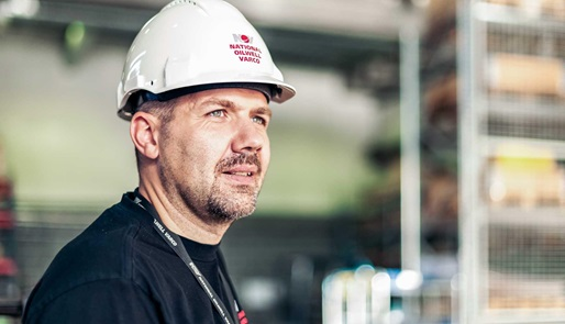 An NOV employee in a warehouse facility