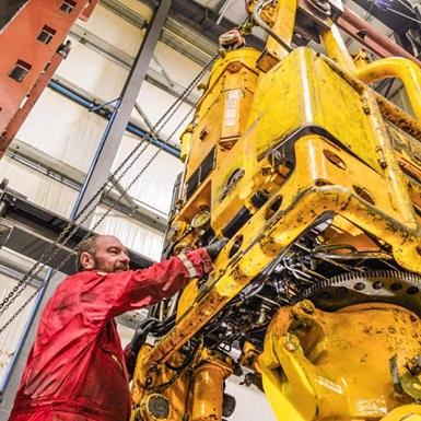 Technician inspecting top drive