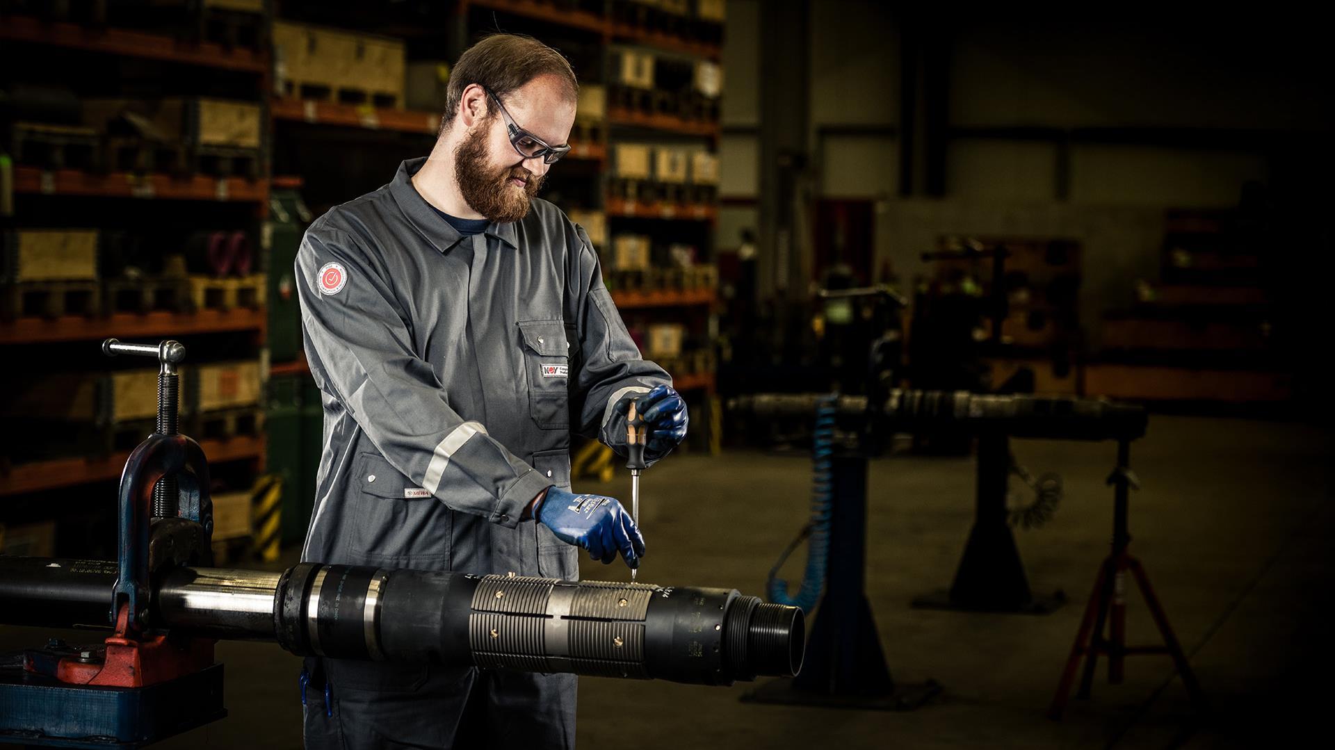 A technician handles an MSF Liner Hanger Packer