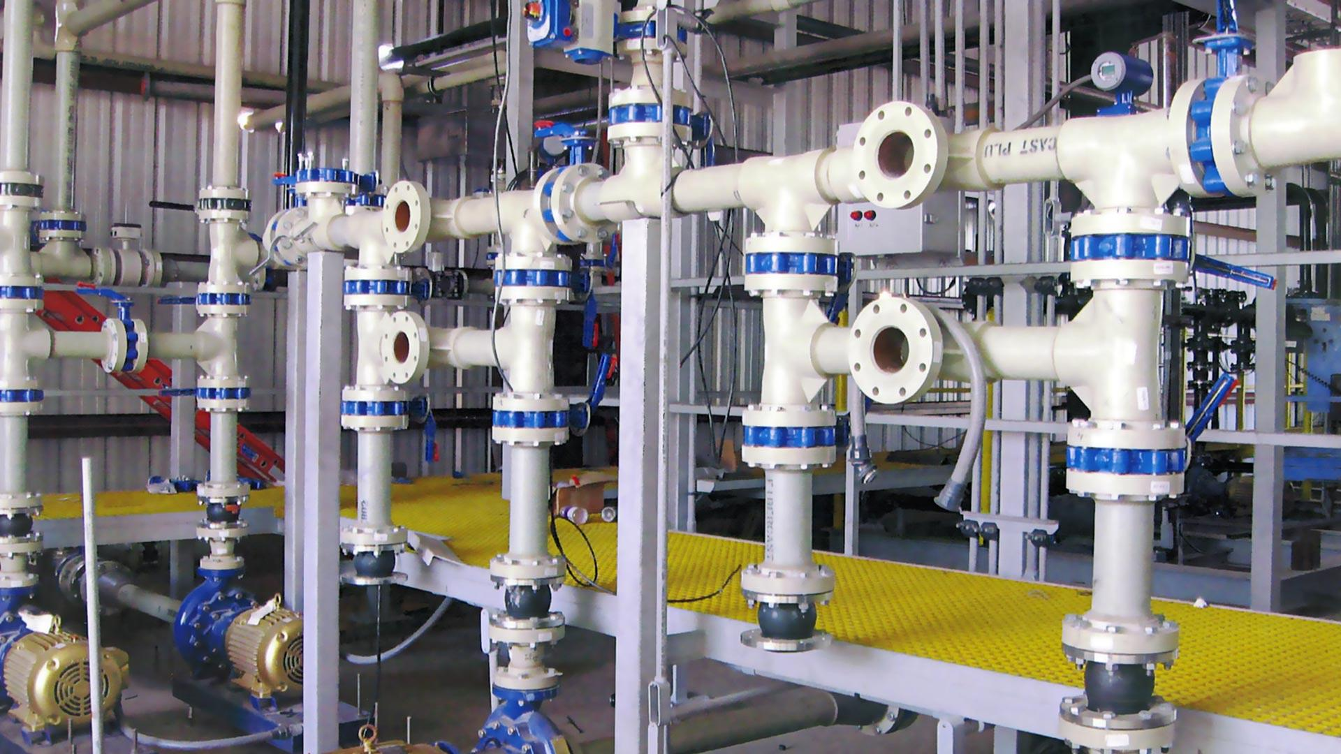 A white and blue Centricast Fiberglass Pipe system