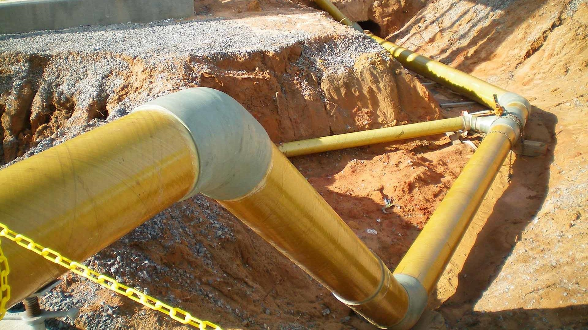 A system of Red Thread HP Fiberglass Pipe laid throughout a ditch