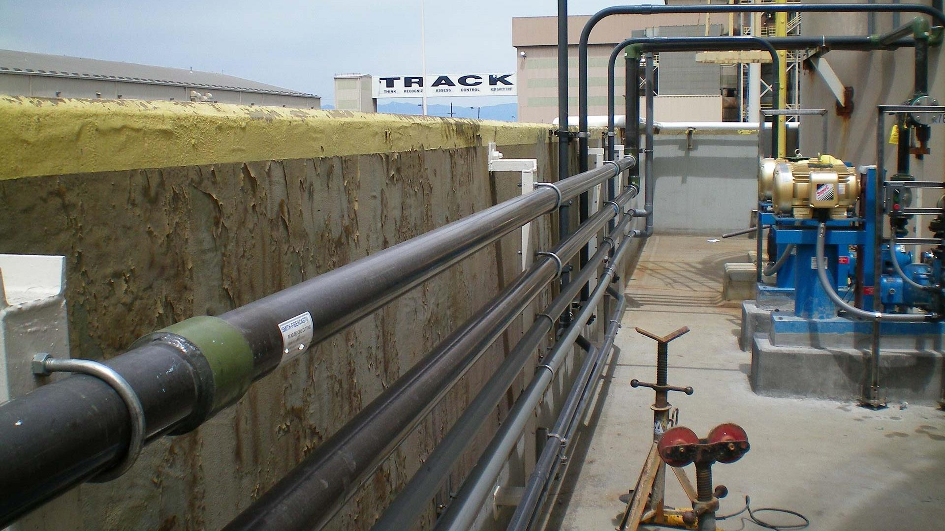 Several Z-Core Fiberglass Pipes line a concrete wall