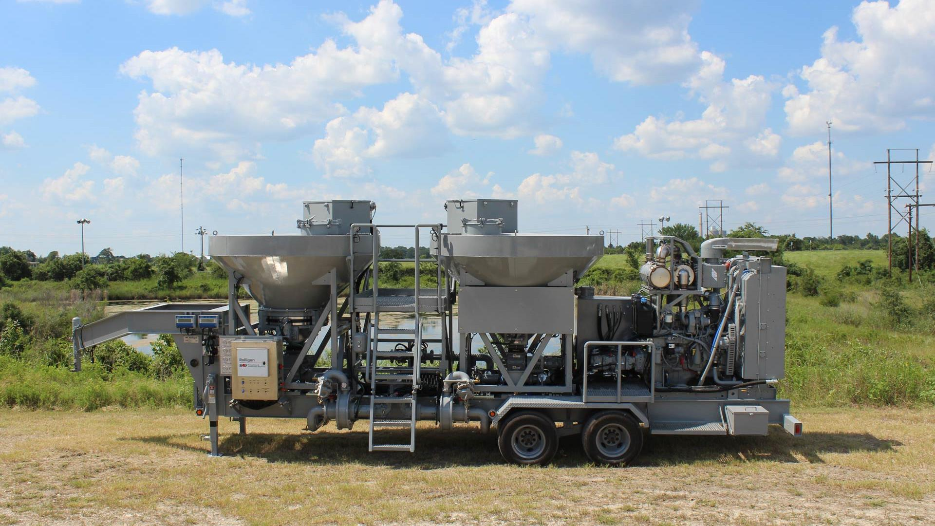 Side view of trailer-mounted Dry Additive Mix Unit