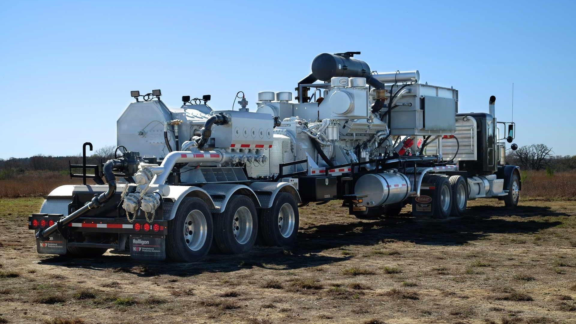 Rear/side view of Trailer-Mounted Frac pumper in field