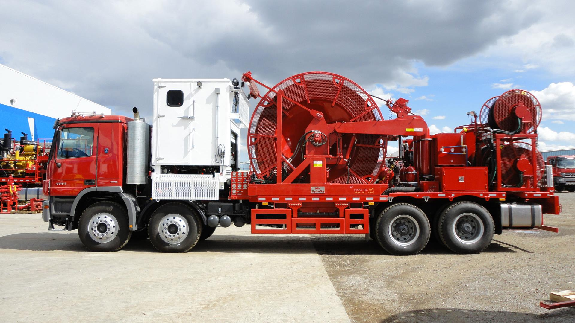 Eye level Red Truck Mounted Coiled Tubing Unit