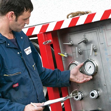 A aftermarket services technician works on a Wireline control panel