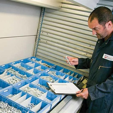 A technician records inventory for Wireline spare parts