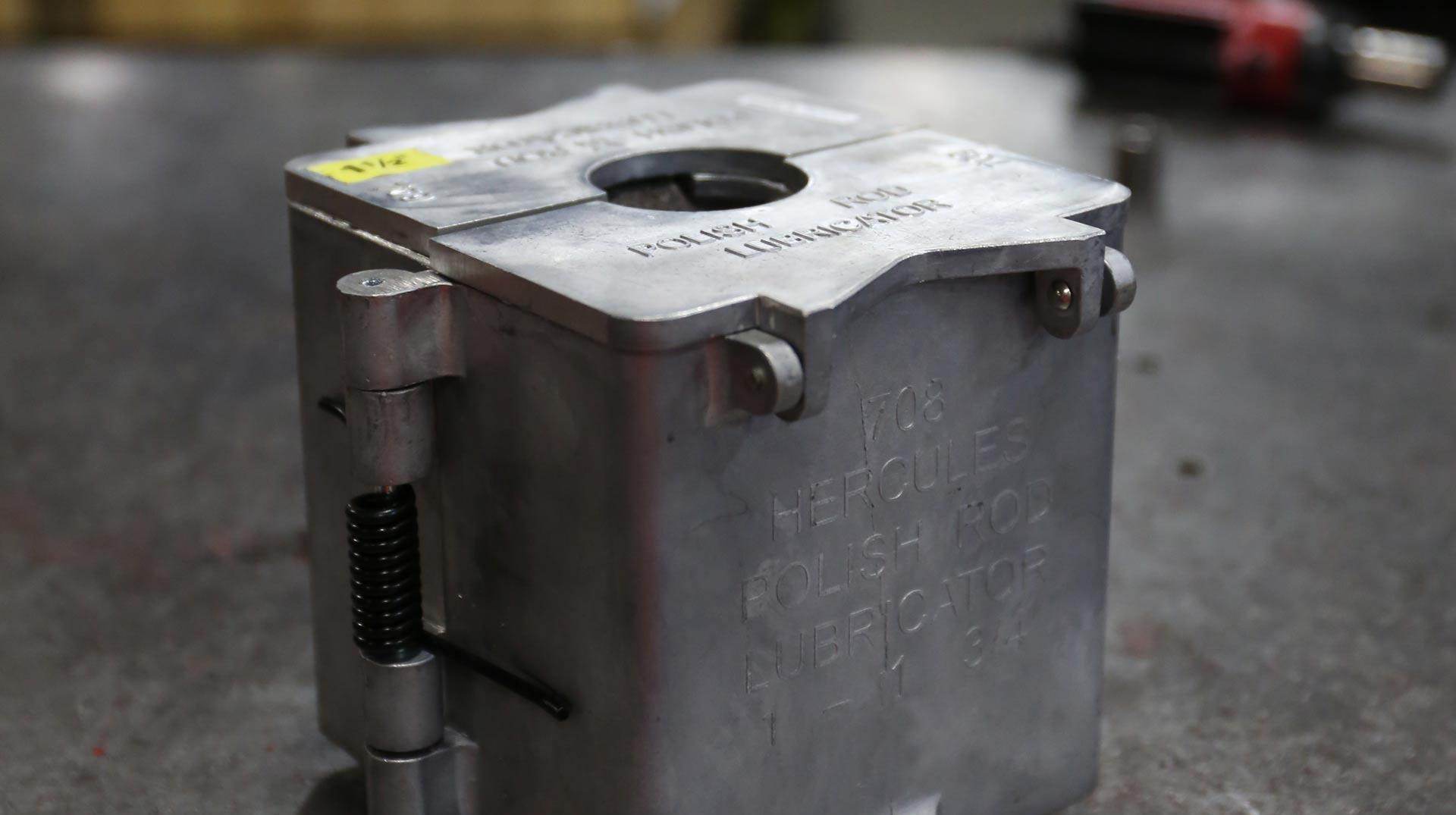 A side view of a Hercules Lubricator