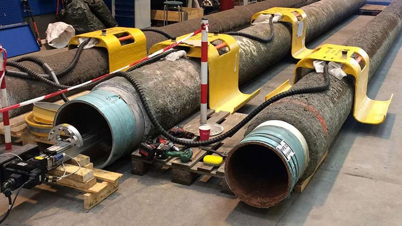 Flexible pipe with pig tracking technology in a shop prior to deployment offshore