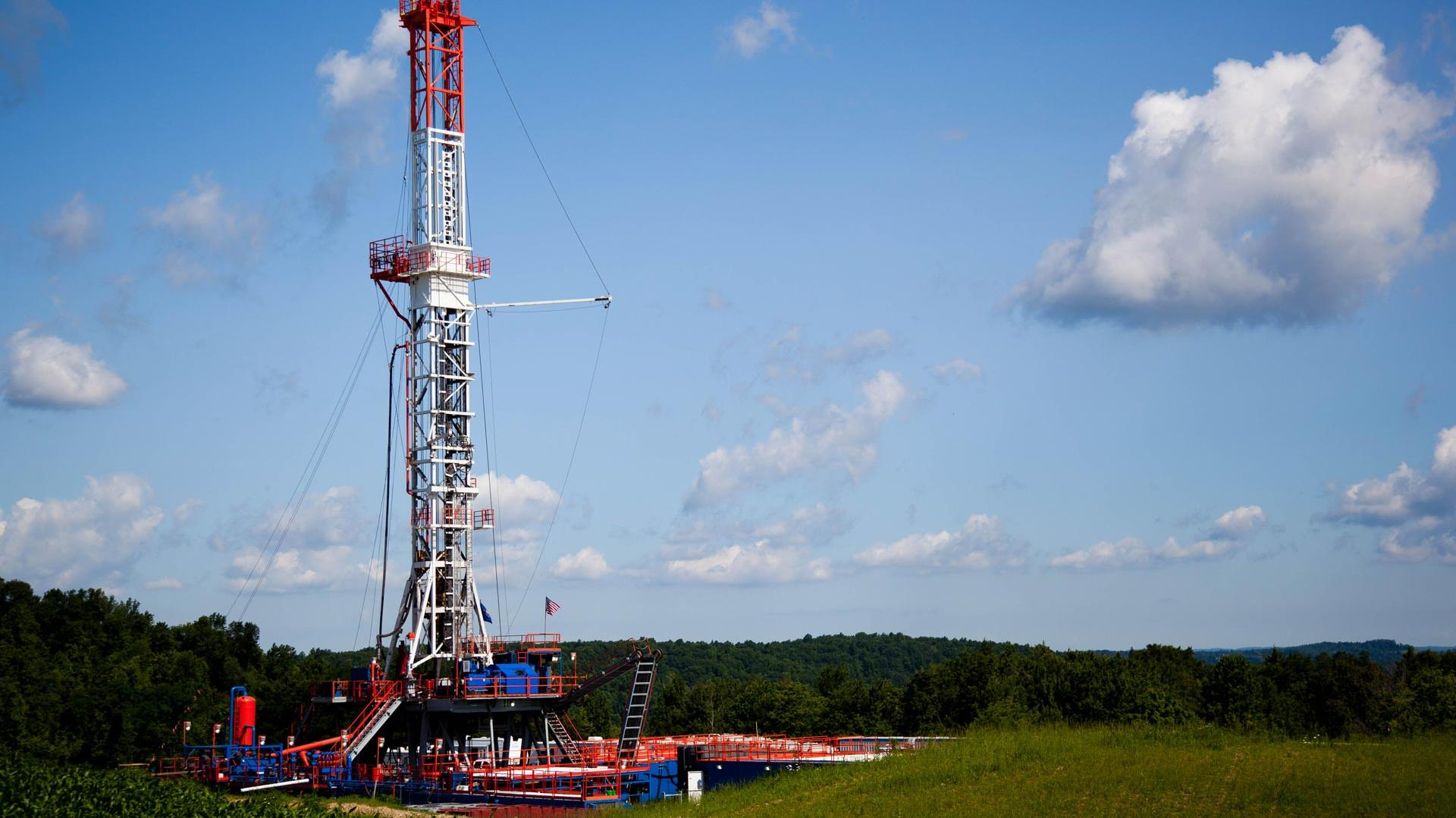 A rig near a corn field running the DrillWell Integrated Business System