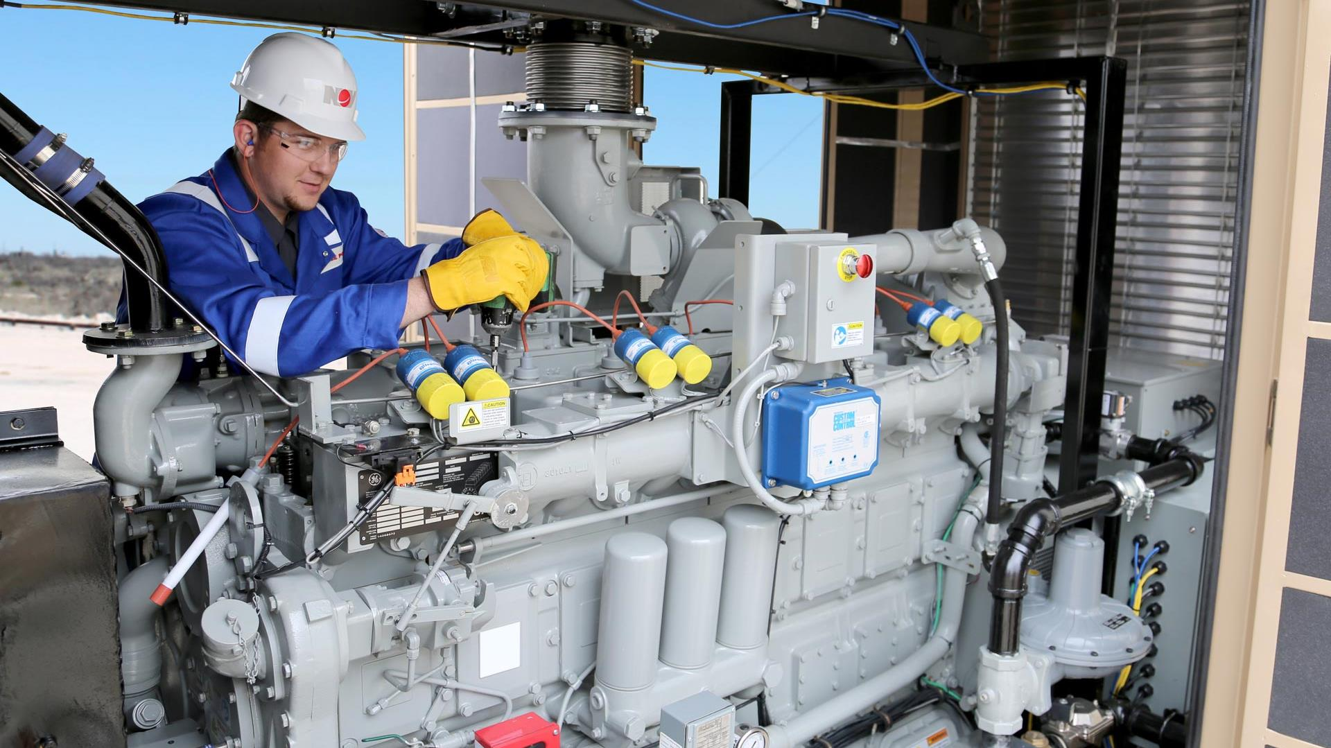 A technician works on a Diesel Generator Service and Spare Parts in Australia Pacific